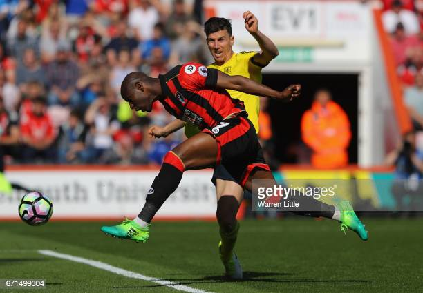 Daniel Ayala of Middlesbrough attempts to stop Benik Afobe of AFC Bournemouth as he shotts on goal during the Premier League match between AFC...