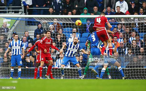 Daniel Ayala of Middlesbrough heads goalwards before Albert Adomah scores their second goal during the Sky Bet Championship match between Brighton...