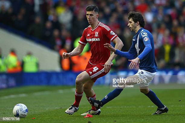 Daniel Ayala of Middlesbrough tracked by Diego Fabbrini of Birmingham City during the Sky Bet Championship match between Birmingham City and...