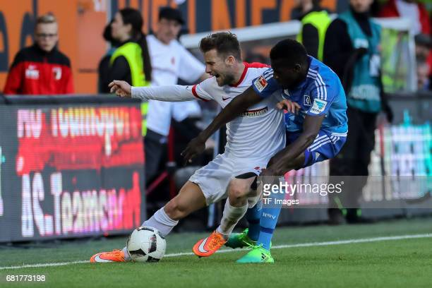 Daniel Baier of Augsburg and Bakery Jatta of Hamburg battle for the ball during the Bundesliga match between FC Augsburg and Hamburger SV at WWK...