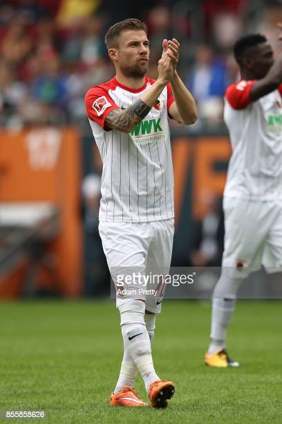 Daniel Baier of Augsburg applauds the fans before the Bundesliga match between FC Augsburg and Borussia Dortmund at WWKArena on September 30 2017 in...