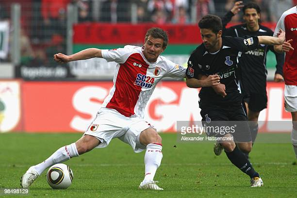 Daniel Baier of Augsburg battles for the ball with Oilivier Veigneau of Duisburg during the Second Bundesliga match between FC Augsburg and MSV...