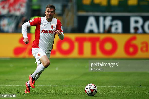 Daniel Baier of Augsburg controles the ball during the Bundesliga match between Eintracht Frankfurt and FC Augsburg at CommerzbankArena on September...
