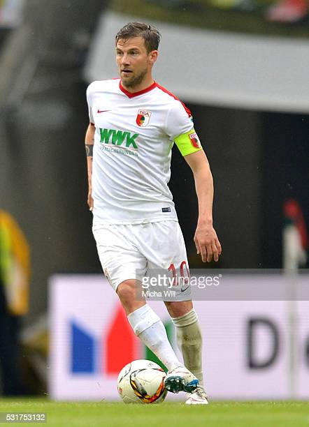 Daniel Baier of Augsburg controls the ball during the Bundesiga match between FC Augsburg and Hamburger SV at SGL Arena on May 14 2016 in Augsburg...