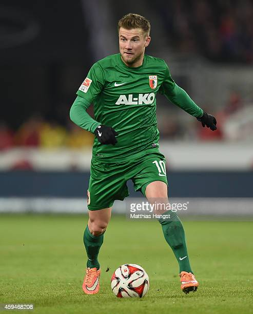 Daniel Baier of Augsburg controls the ball during the Bundesliga match between VfB Stuttgart and FC Augsburg at MercedesBenz Arena on November 23...