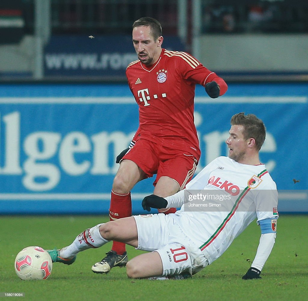 <a gi-track='captionPersonalityLinkClicked' href=/galleries/search?phrase=Daniel+Baier&family=editorial&specificpeople=706624 ng-click='$event.stopPropagation()'>Daniel Baier</a> (R) of Augsburg fights for the ball with <a gi-track='captionPersonalityLinkClicked' href=/galleries/search?phrase=Franck+Ribery&family=editorial&specificpeople=490869 ng-click='$event.stopPropagation()'>Franck Ribery</a> of Bayern during the Bundesliga match between FC Augsburg and FC Bayern Muenchen at SGL Arena on December 8, 2012 in Augsburg, Germany.