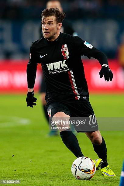 Daniel Baier of Augsburg in action during the First bundesliga match between Hamburger SV and FC Augsburg at Volksparkstadion on December 19 2015 in...
