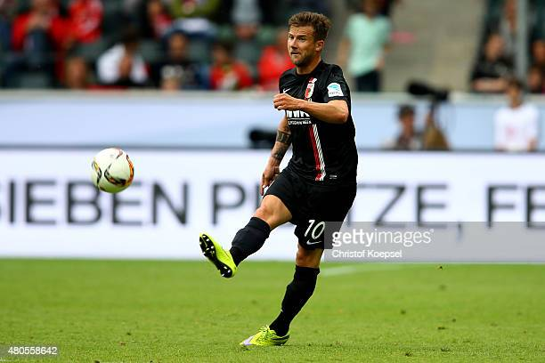 Daniel Baier of Augsburg runs with the ball during the Telekom Cup 2015 final match between Hambruger SV and FC Augsburg at BorussiaPark on July 12...