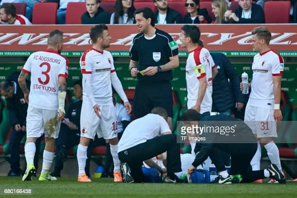 Daniel Baier of Augsburg speak with Manuel Gräfeduring the Bundesliga match between FC Augsburg and Hamburger SV at WWK Arena on April 30 2017 in...