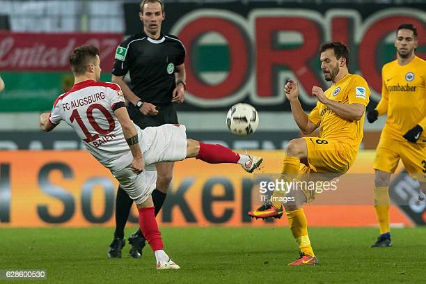 Daniel Baier of Augsburg und Szabolcs Huszti of Frankfurt battle for the ball during the Bundesliga match between FC Augsburg and Eintracht Frankfurt...