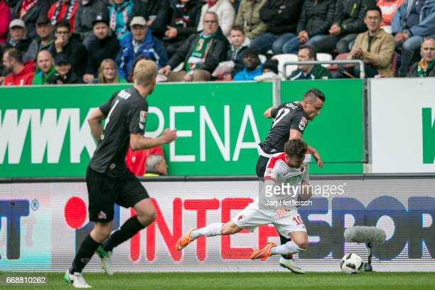Daniel Baier of FC Augsburg and Christian Clemens of Cologne battle for possession during the Bundesliga match between FC Augsburg and 1 FC Koeln at...