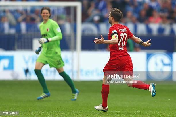 Daniel Baier of FC Augsburg celebrates scoring his teams first goal of the game in the final minutes during the Bundesliga match between FC Schalke...