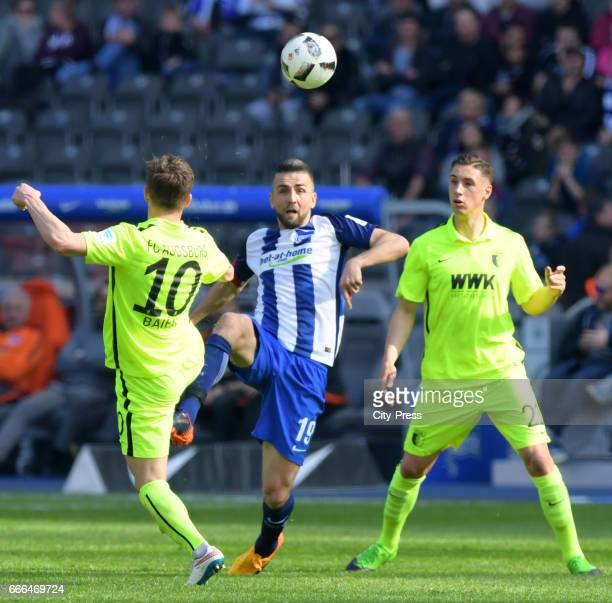 Daniel Baier of FC Augsburg Vedad Ibisevic of Hertha BSC and Dominik Kohr of FC Augsburg during the game between Hertha BSC and FC Augsburg on April...