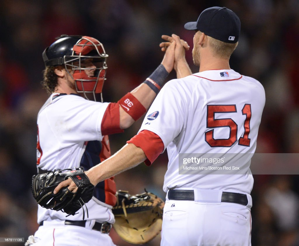 <a gi-track='captionPersonalityLinkClicked' href=/galleries/search?phrase=Daniel+Bard&family=editorial&specificpeople=550283 ng-click='$event.stopPropagation()'>Daniel Bard</a> #51 of the Boston Red Sox celebrates with <a gi-track='captionPersonalityLinkClicked' href=/galleries/search?phrase=Jarrod+Saltalamacchia&family=editorial&specificpeople=836404 ng-click='$event.stopPropagation()'>Jarrod Saltalamacchia</a> #39 after a 7-2 win against the Houston Astros on April 25, 2013 at Fenway Park in Boston, Massachusetts.