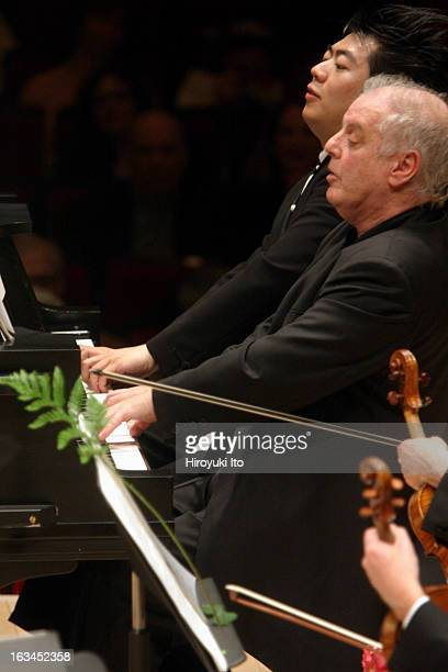 Daniel Barenboim foreground and Lang Lang perform Schubert's 'March Militaire' as an encore at Carnegie Hall on Saturday night March 3 2007
