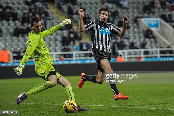 Daniel Barlaser of Newcastle challenges Arsenal Goalkeeper Dejan Iliev during the U21 Barclays Premier League match between Newcastle United and...