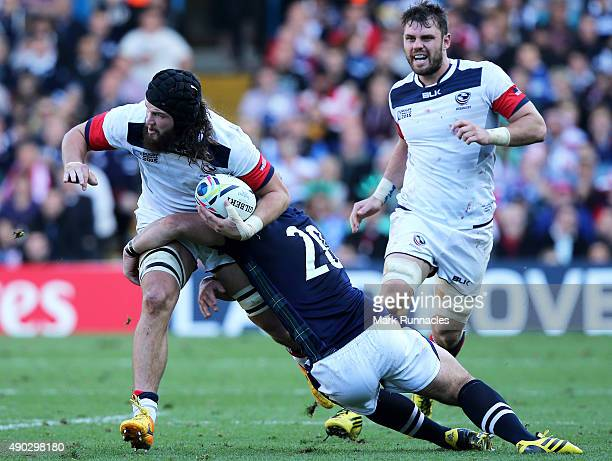 Daniel Barrett of USA is tackled by Fraser Brown of Scotland during the 2015 Rugby World Cup Pool B match between Scotland and USA at Elland Road on...