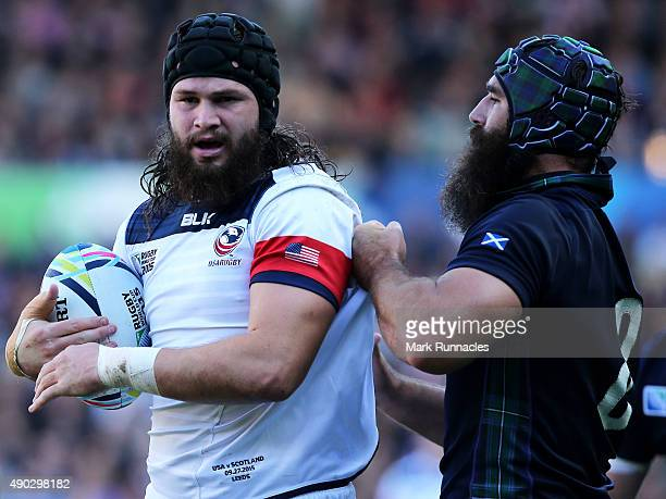 Daniel Barrett of USA tangles with Josh Strauss of Scotland during the 2015 Rugby World Cup Pool B match between Scotland and USA at Elland Road on...