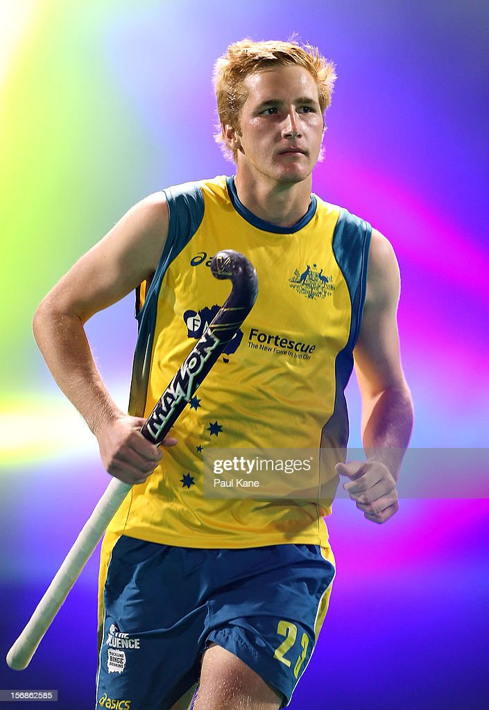 Daniel Beale of the Kookaburras runs onto the field for the start of the mens Australia Kookaburras v India game during day two of the 2012 International Super Series at Perth Hockey Stadium on November 23, 2012 in Perth, Australia.