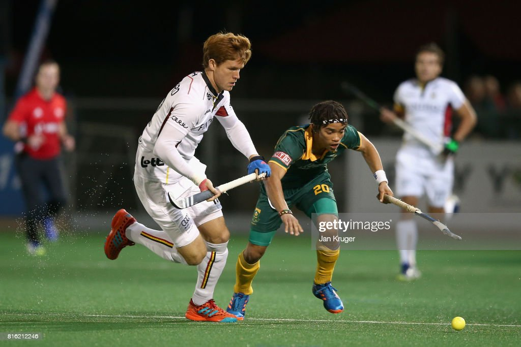 Daniel Bell of South Africa and Gauthier Boccard of Belgium battle for possession during the Group B match between South Africa and Belgium on day five of the FIH Hockey World League - Men's Semi Finals on July 17, 2017 in Johannesburg, South Africa.