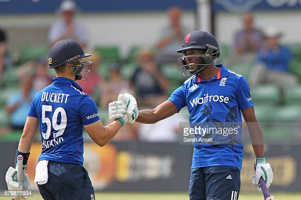 Daniel BellDrummond of England Lions celebrates with teammate Ben Duckett after reaching 150 runs during the Royal London OneDay match between...