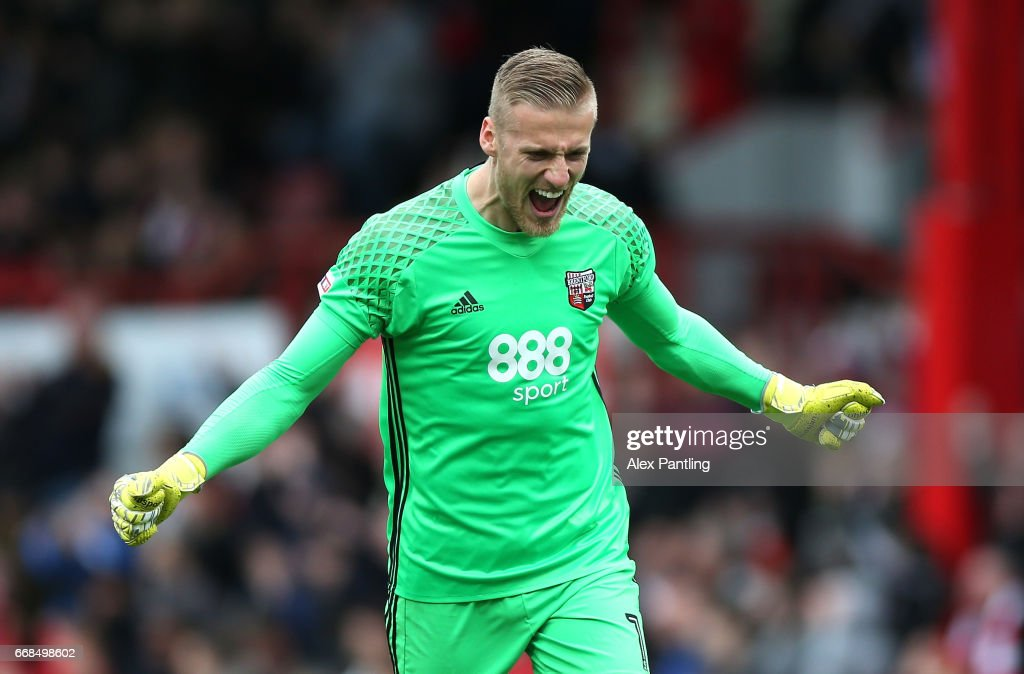 Daniel Bentley of Brentford celebrates after his side score their 2nd goal during the Sky Bet Championship match between Brentford and Derby County at Griffin Park on April 14, 2017 in Brentford, England.