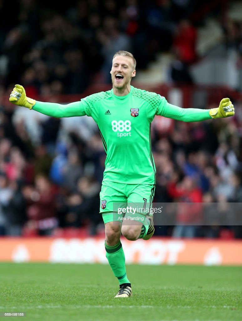 Daniel Bentley of Brentford celebrates after his side score their third goal during the Sky Bet Championship match between Brentford and Derby County at Griffin Park on April 14, 2017 in Brentford, England.