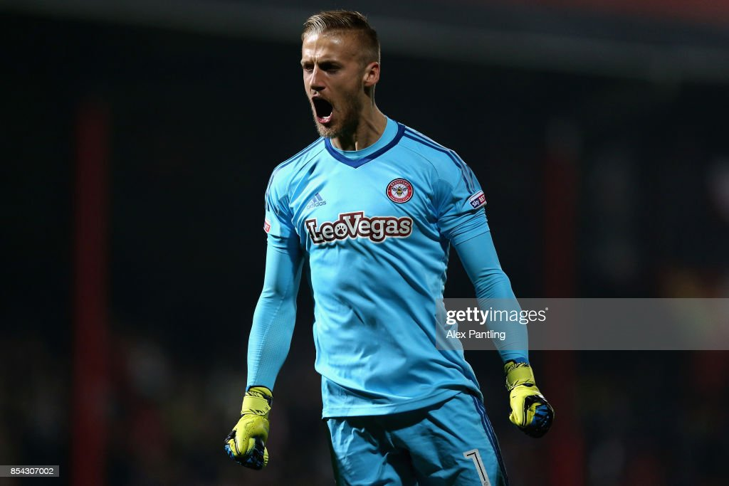Daniel Bentley of Brentford celebrates after his side score their first goal during the Sky Bet Championship match between Brentford and Derby County at Griffin Park on September 26, 2017 in Brentford, England.