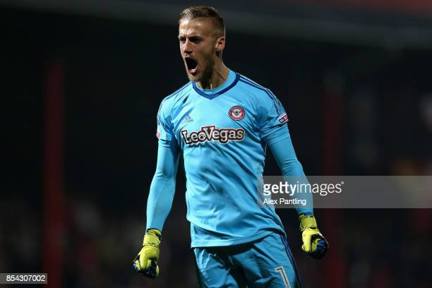 Daniel Bentley of Brentford celebrates after his side score their first goal during the Sky Bet Championship match between Brentford and Derby County...