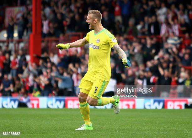 Daniel Bentley of Brentford celebrates his teams opening goal during the Sky Bet Championship match between Brentford and Millwall at Griffin Park on...