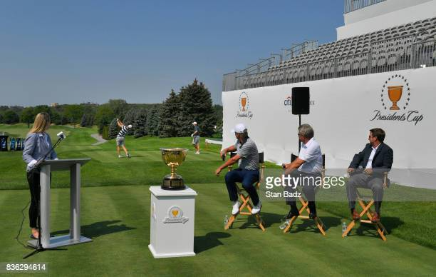 Daniel Berger and Jordan Spieth play shots off the first tee as Presidents Cup Captain Steve Stricker and Nick Price watch during the Presidents Cup...