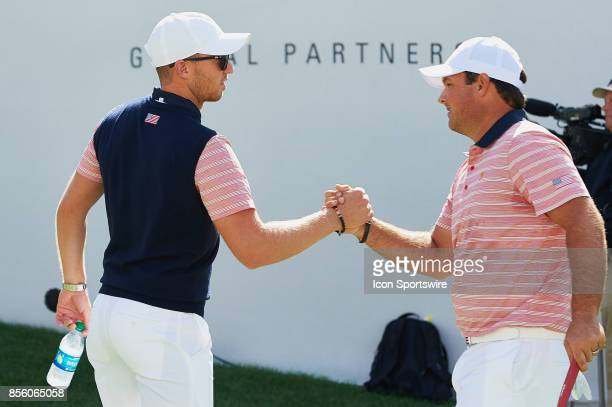 Daniel Berger and Patrick Reed of the American Team shake hands at the first tee during the second round of the Presidents Cup at Liberty National...