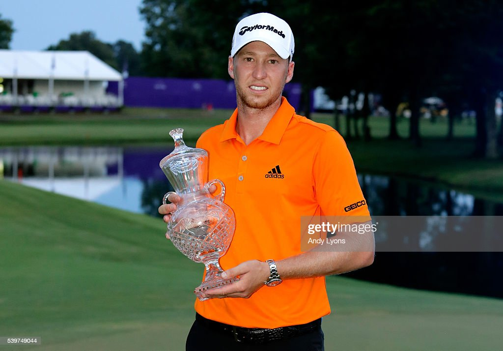 Daniel Berger celebrates with the trophy after winning the FedEx St. Jude Classic during the final round at TPC Southwind on June 12, 2016 in Memphis, Tennessee.