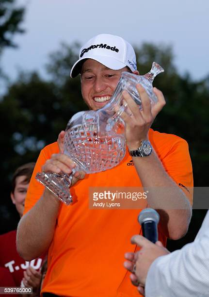 Daniel Berger celebrates with the trophy after winning the FedEx St Jude Classic during the final round at TPC Southwind on June 12 2016 in Memphis...