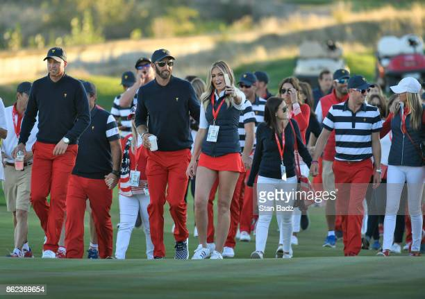 Daniel Berger Dustin Johnson and other members of the US Team walk up the 14th fairway to the trophy ceremony after defeating the International Team...