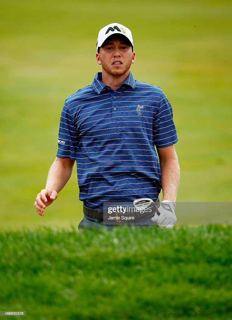 Daniel Berger jumps up to see where his ball landed on the 15th green during the Second Round of the BMW Championship at Conway Farms Golf Club on September 18, 2015 in Lake Forest, Illinois.