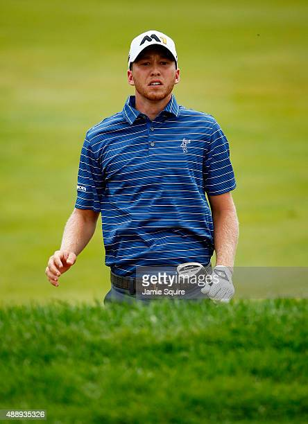 Daniel Berger jumps up to see where his ball landed on the 15th green during the Second Round of the BMW Championship at Conway Farms Golf Club on...