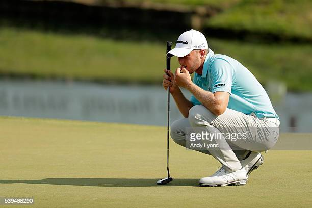 Daniel Berger lines up a putt on the 18th green during the third round of the FedEx St Jude Classic at TPC Southwind on June 11 2016 in Memphis...