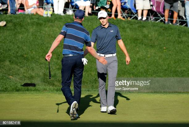 Daniel Berger of the United States congratulates Jordan Spieth of the United States during the playoff of the Travelers Championship on June 25 at...