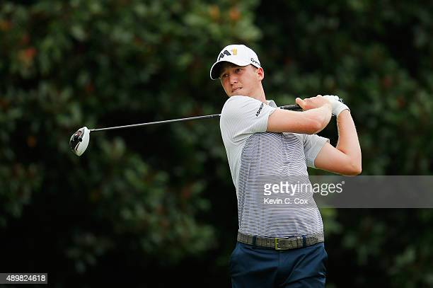 Daniel Berger of the United States hits his tee shot on the fifth hole during the first round of the TOUR Championship By CocaCola at East Lake Golf...