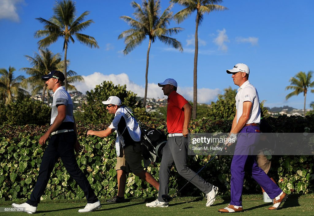 Daniel Berger of the United States, Jordan Spieth of the United States and Justin Thomas of the United States walk from the 18th tee during the second round of the Sony Open In Hawaii at Waialae Country Club on January 13, 2017 in Honolulu, Hawaii.
