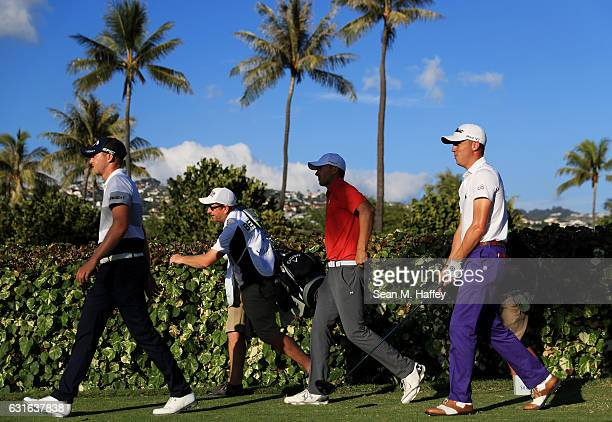 Daniel Berger of the United States Jordan Spieth of the United States and Justin Thomas of the United States walk from the 18th tee during the second...