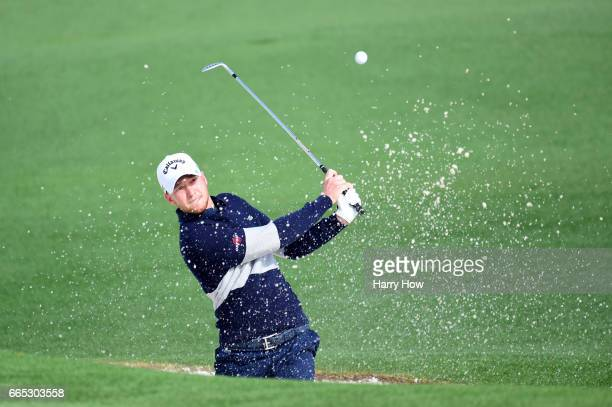 Daniel Berger of the United States plays a shot from a bunker on the second hole during the first round of the 2017 Masters Tournament at Augusta...