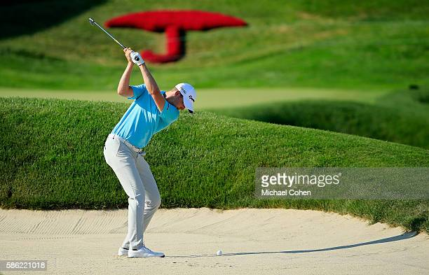 Daniel Berger of the United States plays his second shot from a bunker on the 18th hole during the second round of the Travelers Championship at the...