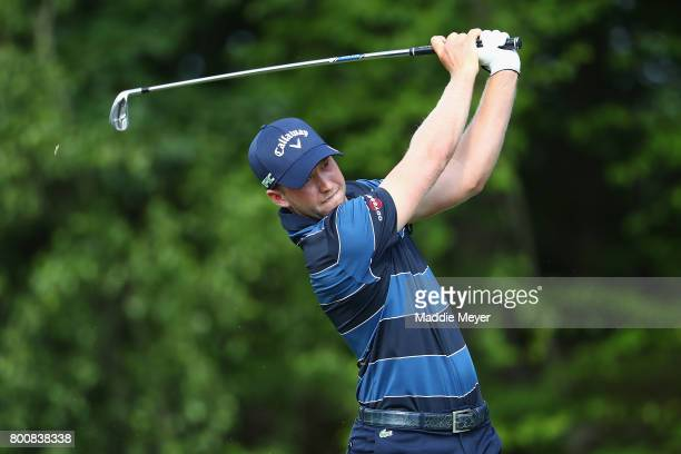 Daniel Berger of the United States plays his shot from the 14th tee during the final round of the Travelers Championship at TPC River Highlands on...