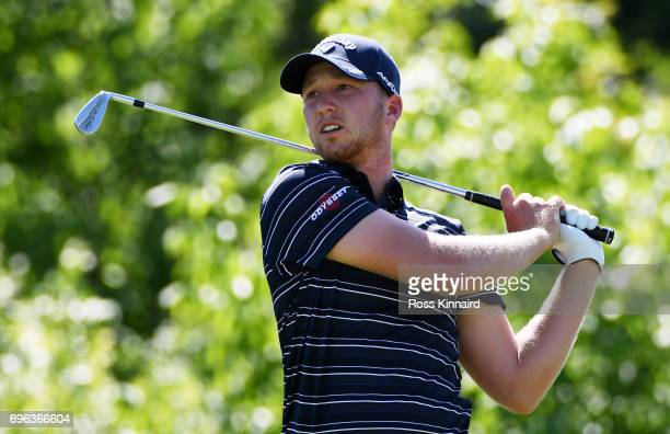 Daniel Berger of the United States plays his shot from the 16th tee during the first round of the 2017 US Open at Erin Hills on June 15 2017 in...