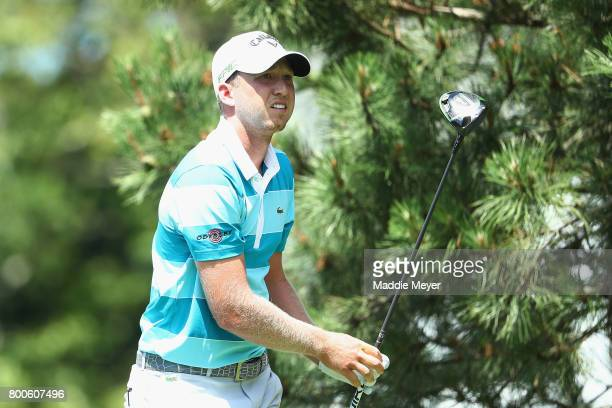 Daniel Berger of the United States plays his shot from the sixth tee during the third round of the Travelers Championship at TPC River Highlands on...