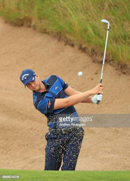 Daniel Berger of the United States plays his shot out of the bunker on the 11th hole during a practice round prior to the 2017 US Open at Erin Hills...