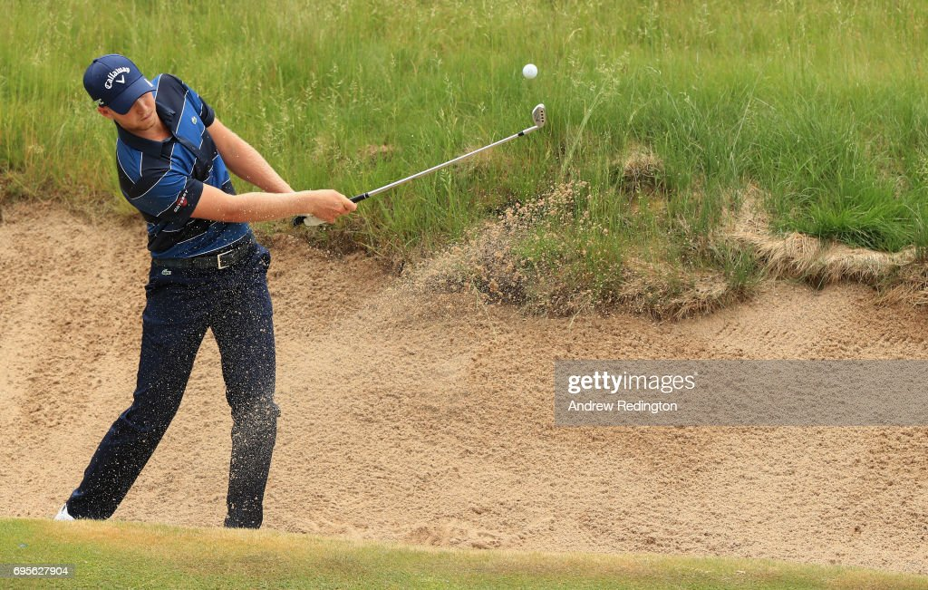 Daniel Berger of the United States plays his shot out of the bunker on the 16th hole during a practice round prior to the 2017 U.S. Open at Erin Hills on June 13, 2017 in Hartford, Wisconsin.