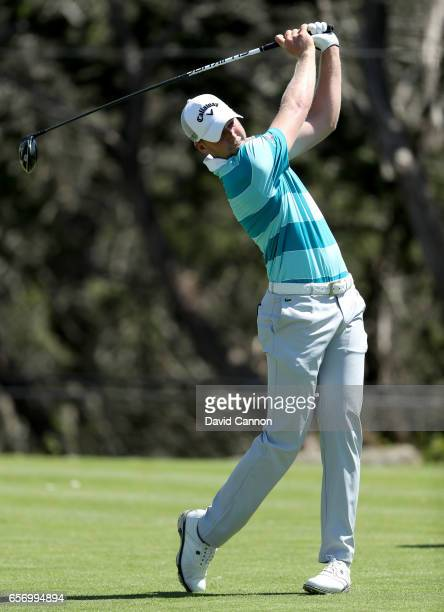 Daniel Berger of the United States plays his tee shot on the par 4 second hole in his match against Phil Mickelson during the second round of the...